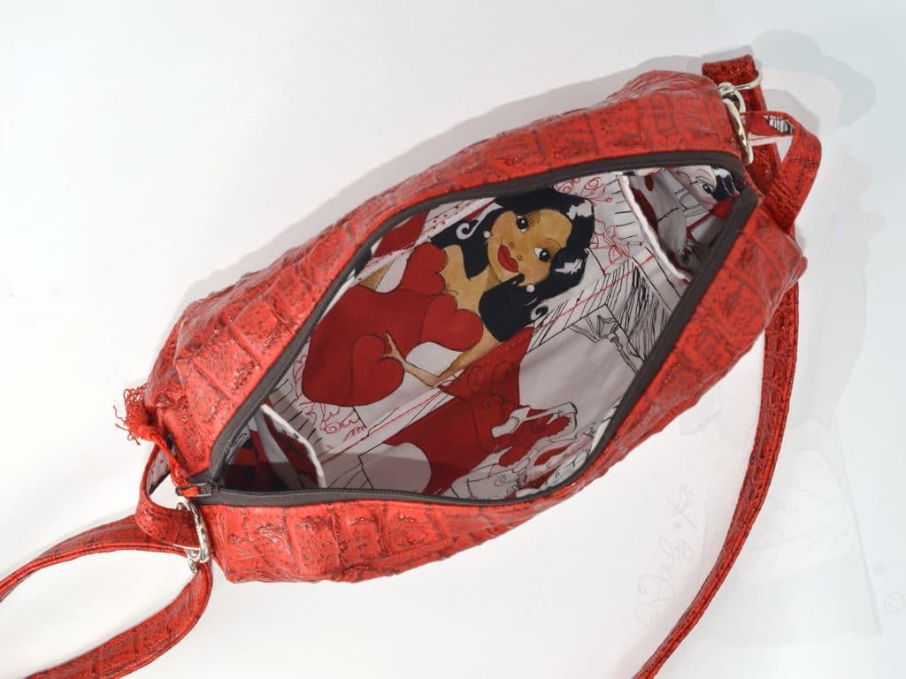 Intérieur du sac à porter en bandoulière, vue du dessus