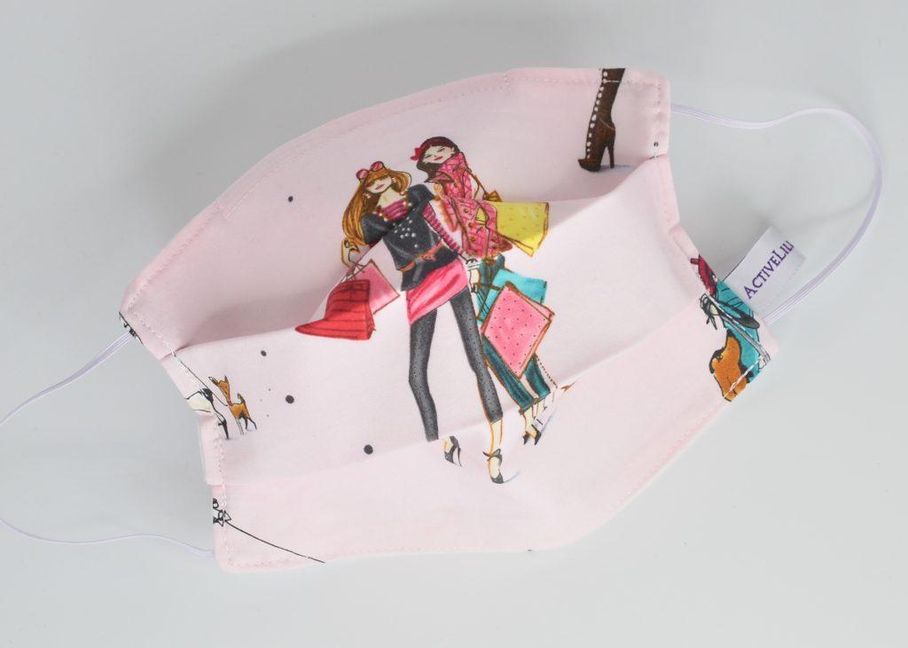 Masque en tissu à soufflet shopping rose