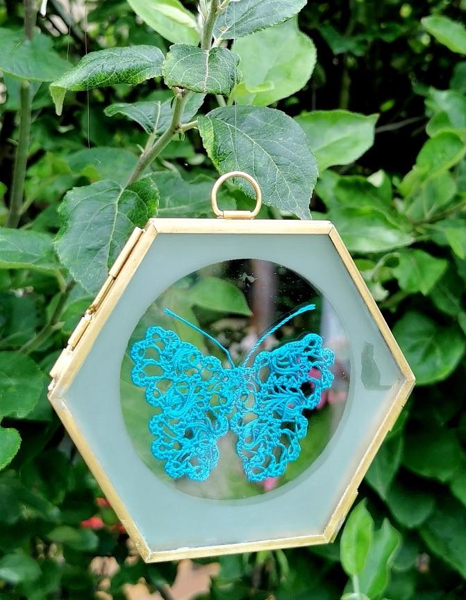 Papillon de dentelle bleu pour une décoration intérieure